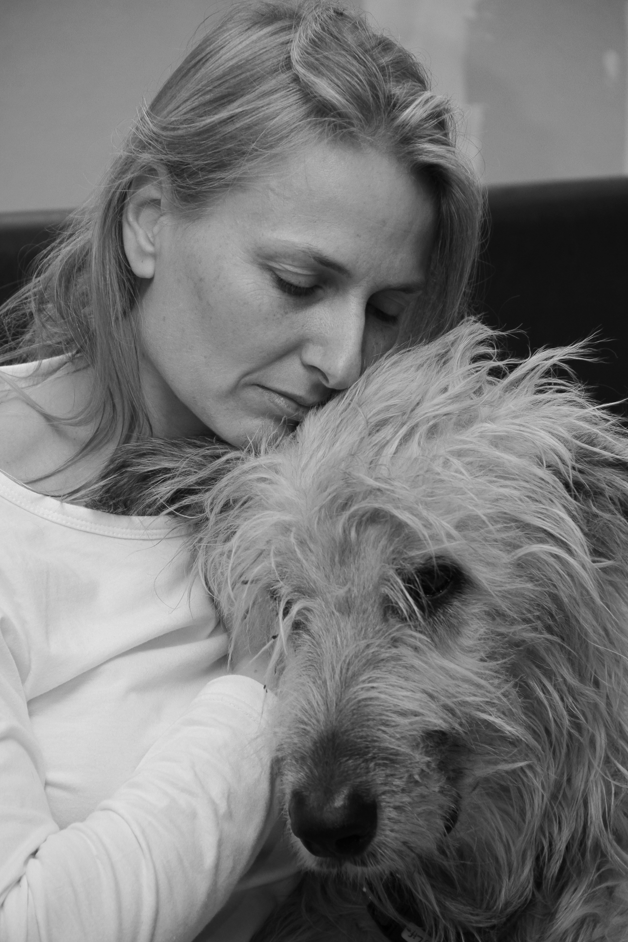 Two of my favourites! Liz and Dilbert (my Irish Wolfhound, whose real name was Della) share a cuddle on the sofa. The Black & White head & shoulders shot shows Liz (eyes closed) rubbing Dilbert's ear as Dilbert pushes into Liz's shoulder. Taken in France in 2011.