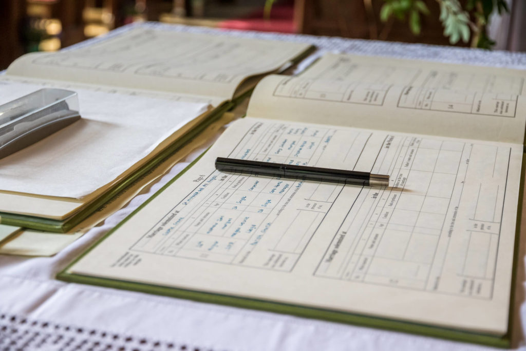 A close up image of the filled in wedding register awaiting the signatures of the Bride & Groom.
