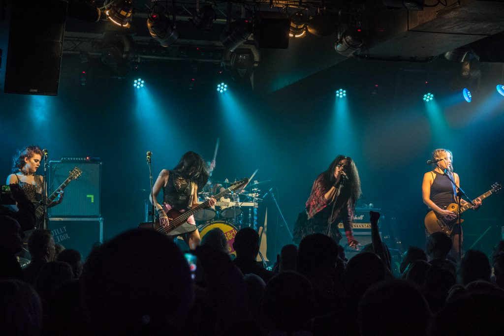 A wide angle colour photograph of all of The Sex Pissed Dolls performing on stage at The River Rooms in Stourbridge