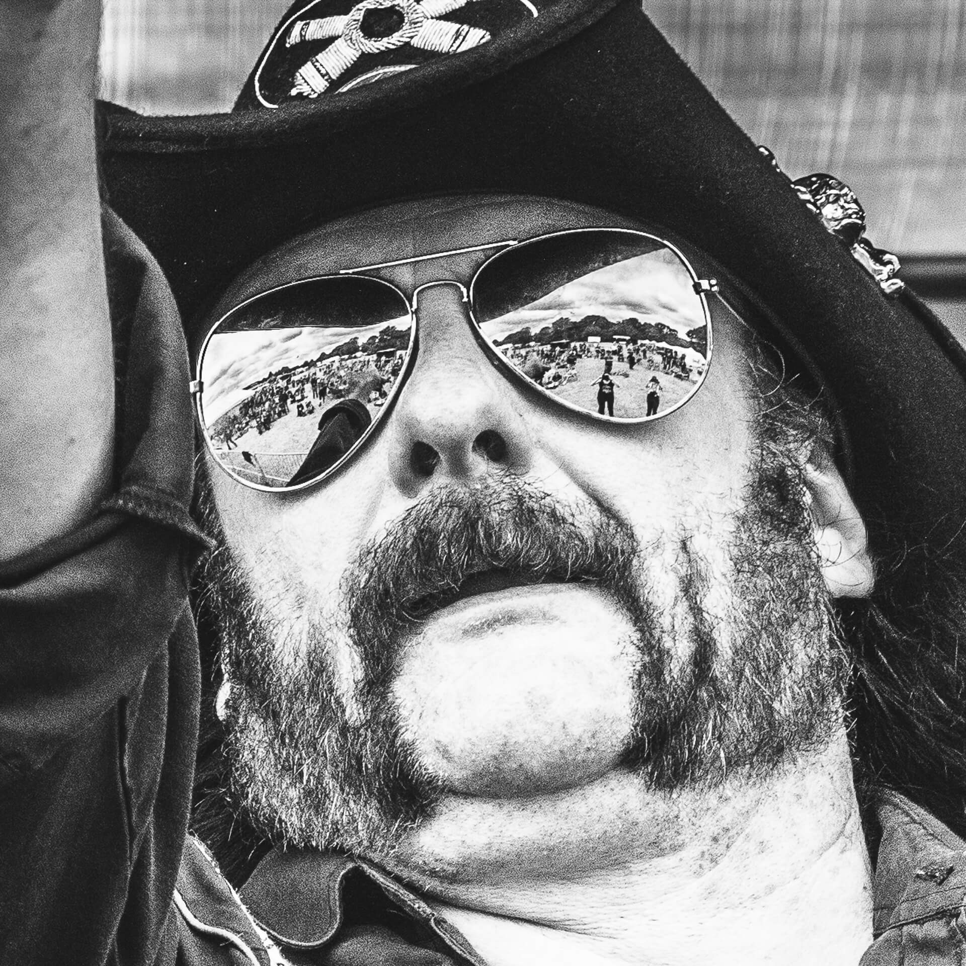 A very close up Black & White headshot of Lemmy aka Rob Campbell (the lead singer of Motorheadache, a Motorhead tribute band) on stage at The Drunken Monkey Festival 2017