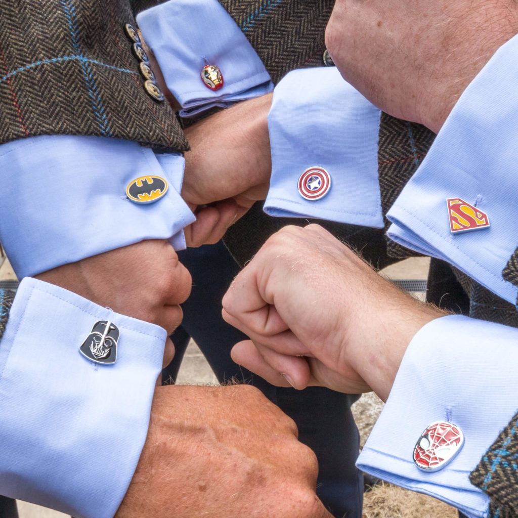 The Best Men show off their unique Cult/Superhero cufflinks featuring (from L - R) Darth Vader, Batman, Ironman, Captain America, Superman, and Spiderman.
