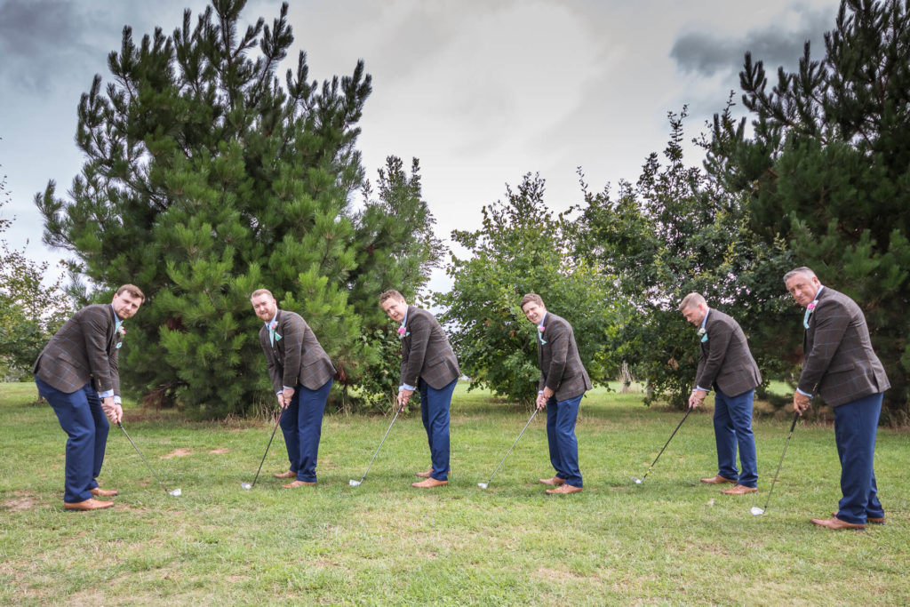 The Grooms party take some time out to practice their golfing postures and swings prior to getting ready.