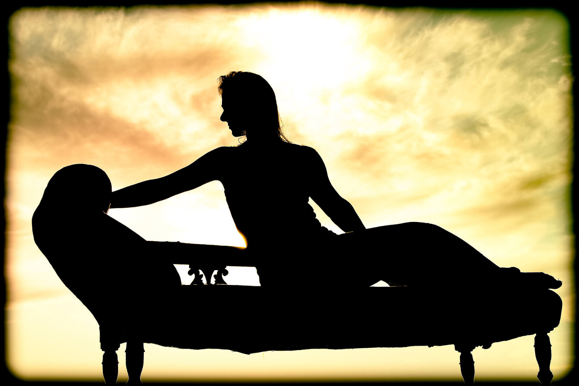 A silhouetted Liz poses in a classic pose on a Chaise Longue. Taken in France 2011.