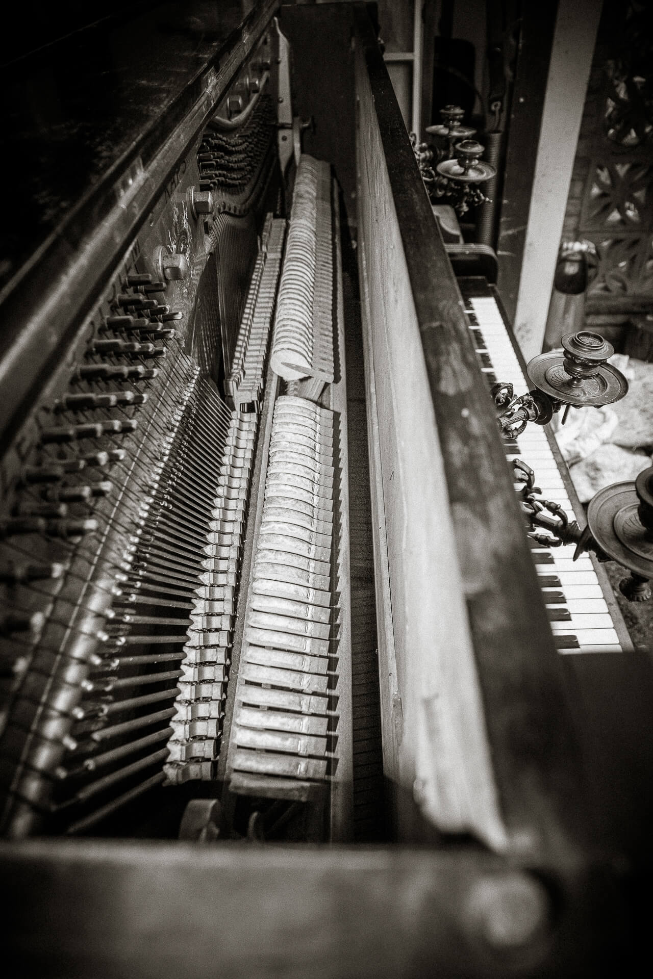 Black & White Photograph Of The Internal Workings of Painted Vintage Piano