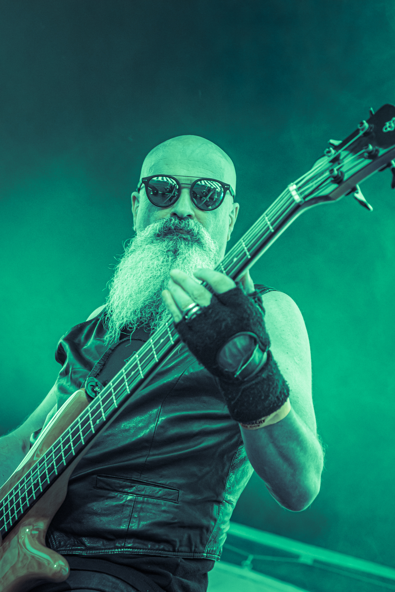 An upper body shot of the bearded Mr Xenophon Haber-Percy playing his bass on stage with Your Mom at the Dubs of Anarchy Festival 2019