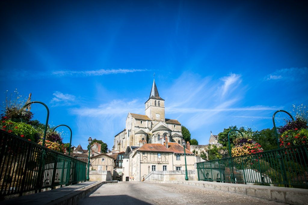 Montmorillion Church (France) sits against a vivid blue sky
