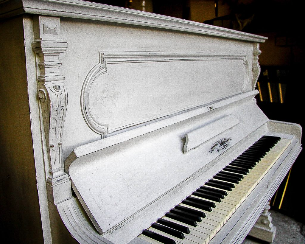 Close Up Detail Of A Shabby Chic Style Painted Vintage Piano In Grey