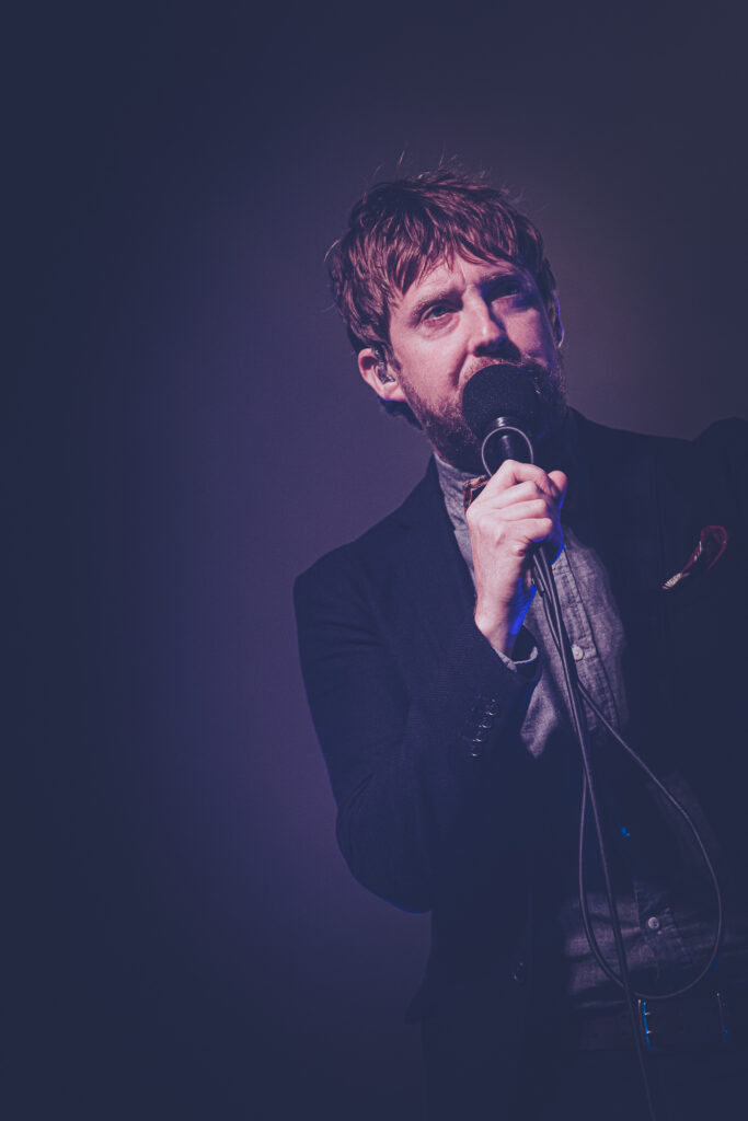 A desaturated image of Charles Richard Wilson, aka Ricky Wilson lead singer of the Kaiser Chiefs on stage at Lakefest 2019