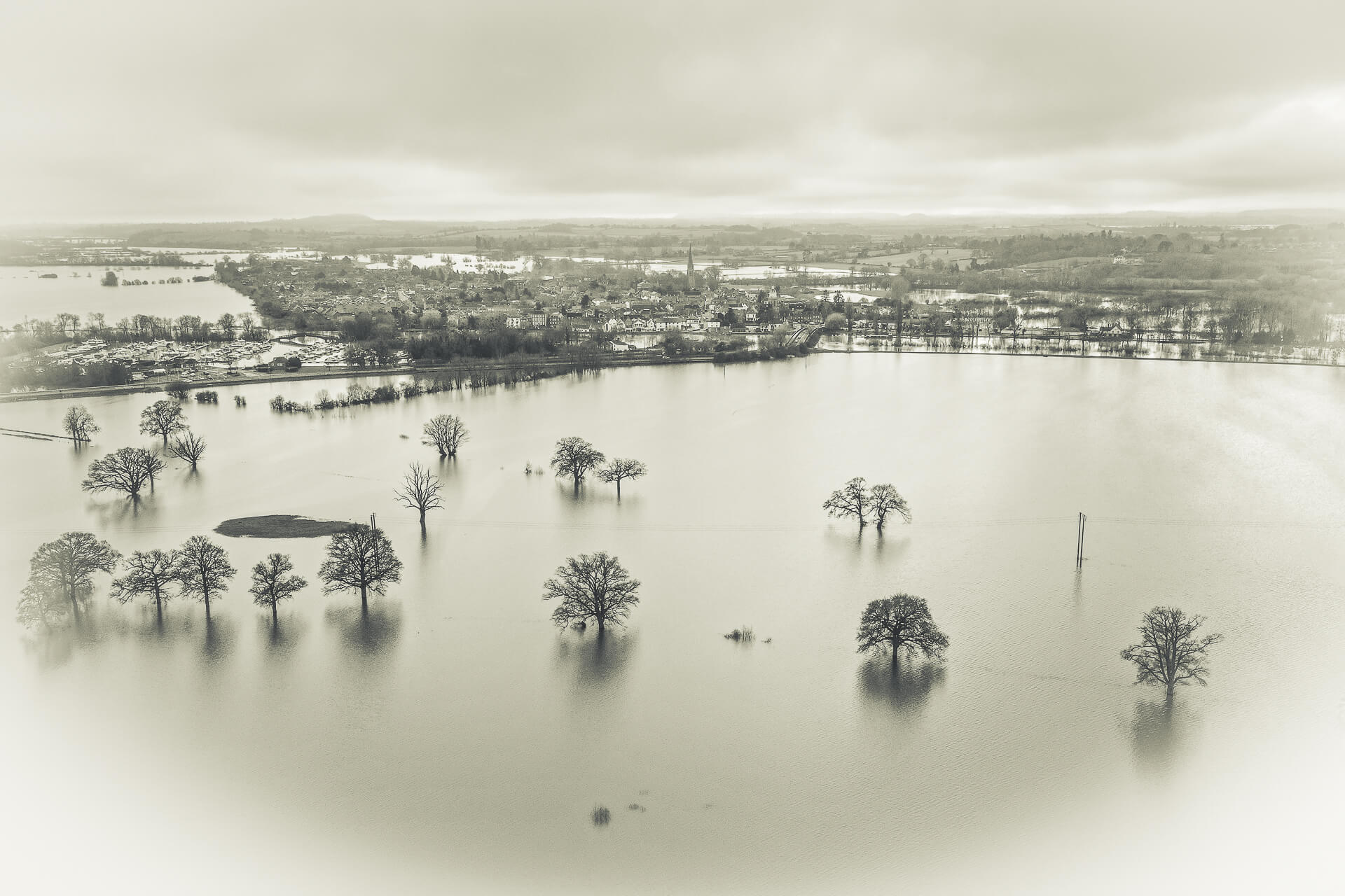 A B&W image of the flooding around Upton-Upon-Severn as seen from the air; taken with a DJI Mavic 2 Pro in February 2021