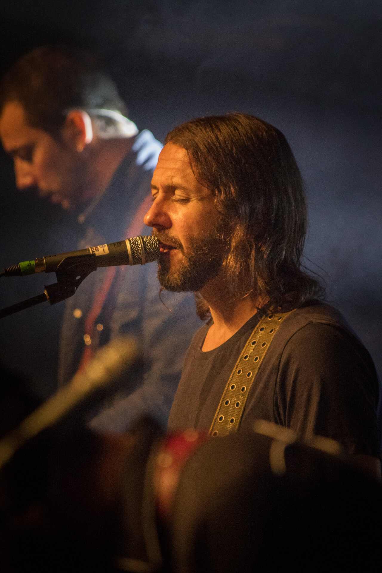 A close up colour photograph of Feeder lead singer Grant Nicholas singing at Lakefest 2017.