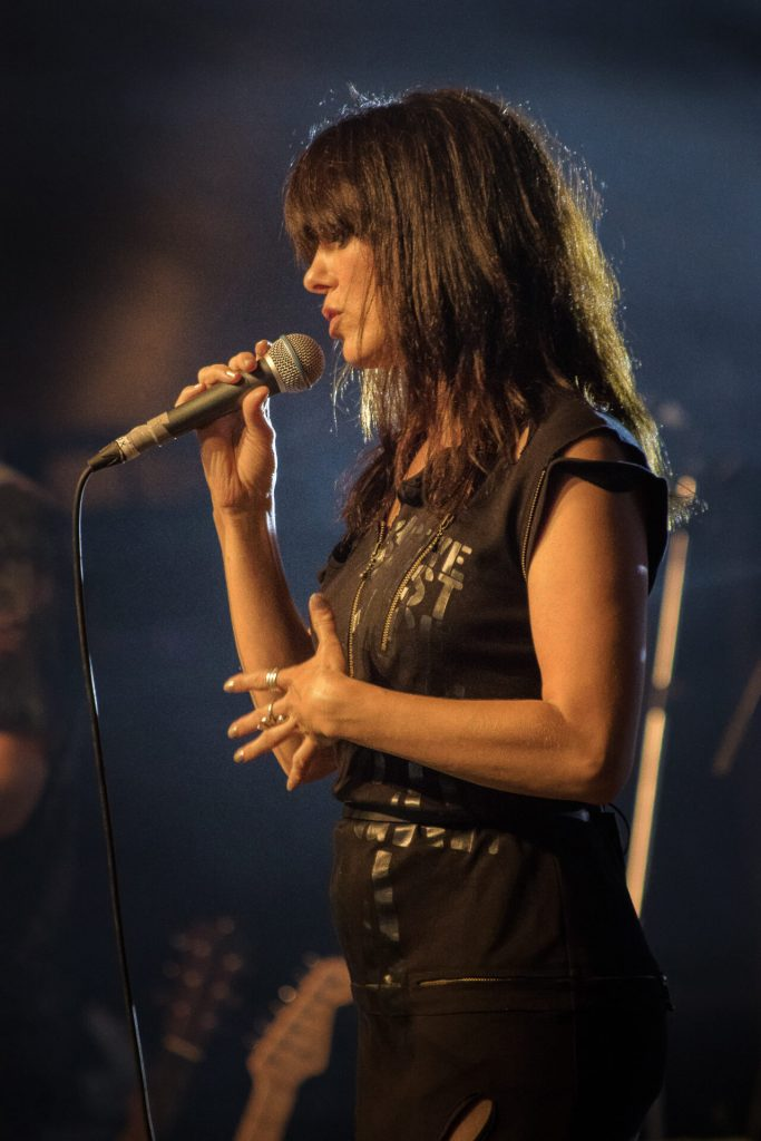 A colour top half side view picture of Imelda May singing on stage at Lakefest 2017.